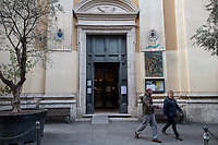 """Church: open (but mass and events are not allowed). <br /> <br /> Trastevere.<br /> <br /> Rome, 12/03/2020. Documenting Rome under the Italian Government lockdown for the Outbreak of the Coronavirus (SARS-CoV-2 - COVID-19) in Italy. On the evening of the 11 March 2020, the Italian Prime Minister, Giuseppe Conte, signed the March 11th Decree Law """"Step 4 Consolidation of 1 single Protection Zone for the entire national territory"""" (1.). The further urgent measures were taken """"in order to counter and contain the spread of the COVID-19 virus"""" on the same day when the WHO (World Health Organization, OMS in Italian) declared the coronavirus COVID-19 as a pandemic (2.).<br /> ISTAT (Italian Institute of Statistics) estimates that in Italy there are 50,724 homeless people. In Rome, around 20,000 people in fragile condition have asked for support. Moreover, there are 40,000 people who live in a state of housing emergency in Rome's municipality.<br /> March 11th Decree Law (1.): «[…] Retail commercial activities are suspended, with the exception of the food and basic necessities activities […] Newsagents, tobacconists, pharmacies and parapharmacies remain open. In any case, the interpersonal safety distance of one meter must be guaranteed. The activities of catering services (including bars, pubs, restaurants, ice cream shops, patisseries) are suspended […] Banking, financial and insurance services as well as the agricultural, livestock and agri-food processing sector, including the supply chains that supply goods and services, are guaranteed, […] The President of the Region can arrange the programming of the service provided by local public transport companies […]».<br /> Updates: on the 12.03.20 (6:00PM) in Italy there 14.955 positive cases; 1,439 patients have recovered; 1,266 died.<br /> <br /> Footnotes & Links:<br /> Info about COVID-19 in Italy: http://bit.do/fzRVu (ITA) - http://bit.do/fzRV5 (ENG)<br /> 1. March 11th Decree Law http://bit.do/fzREX (ITA) - http://bit.d"""