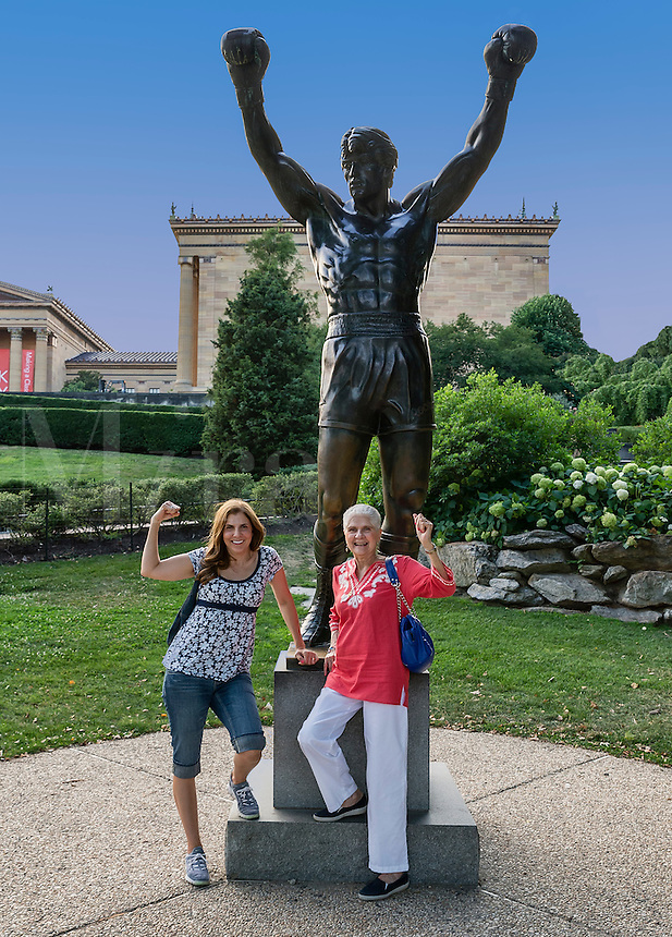 Tourists pose with the Rock statue in from of the Philadelphia Museum of Art.