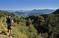 Backpacker/hiker walking in Alpes de Haute Provence near Le Poil between Verdon and Digne. France..