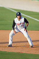 Omar Narvaez (10) of the Kannapolis Intimidators takes his lead off of first base against the Hickory Crawdads at CMC-Northeast Stadium on May 4, 2014 in Kannapolis, North Carolina.  The Intimidators defeated the Crawdads 3-1.  (Brian Westerholt/Four Seam Images)