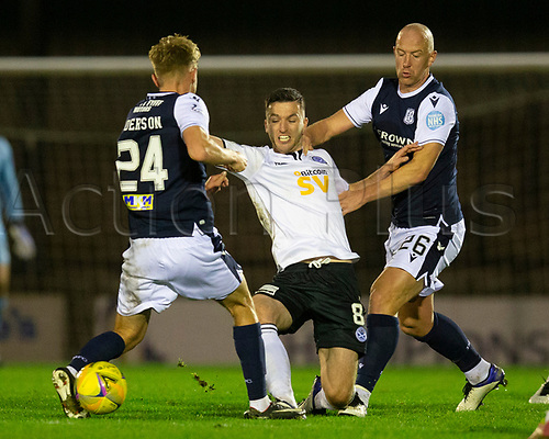 21st November 2020; Somerset Park, Ayr, South Ayrshire, Scotland; Scottish Championship Football, Ayr United versus Dundee FC; Michael Miller of Ayr United challenges for the ball with Max Anderson and Charlie Adam of Dundee