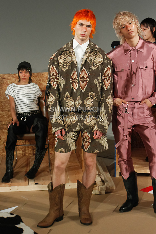 "Model poses in an outfit from the Private Policy Spring Summer 2018 ""Trinkets"" collection, for New York Mens Day at Dune Studios on July 10, 2017; duing New York Fashion Week: Mens Spring Summer 2018."