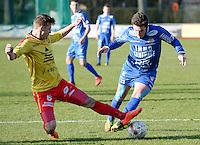 FC Knokke - OMS Ingelmunster : tackle van Gianni Derieuw (links) op Gert Van Walle (r)<br /> Foto VDB / Bart Vandenbroucke