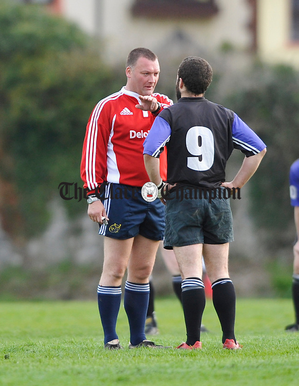 The referee has a word with Kilrush's Raymond Conway  during the Webb Cup final at Ennis RFC grounds. Photograph by John Kelly.