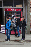 Serbia. Veliki Trnovac (in Albanian: Tërnoc i Madh) is a town in the municipality of Bujanovac, located in the Pčinja District of southern Serbia. A group of Albanian teenagers on their way to school play with their mobile phones. They stand on the road near a Coca Cola machine which sells from a fridge all kind of different beverages, such as bottles of water, Coca-Cola, Fanta , Sprite, Iced Tea, … Street life. Bujanovac is located in the geographical area known as Preševo Valley. The Pestalozzi Children's Foundation (Stiftung Kinderdorf Pestalozzi) is advocating access to high quality education for underprivileged children. It supports in Bujanovac a project called» Our towns, our schools». 16.4.2018 © 2018 Didier Ruef for the Pestalozzi Children's Foundation