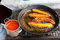 Antigua, Guatemala.  Frying Plantain, Hot Sauce Alongside.
