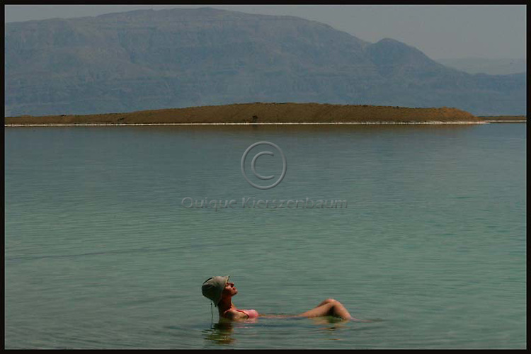 A woman floats in the mineral-rich waters of the Dead Sea at the Ein Bokek Hotels complex at the Dead Sea in southern Israel. The inland sea which separates between Israel and Jordan is retreating by about a meter a year as the two countries divert almost 90% of the Jordan River waters that for thousands of years fed the mineral-rich sea. They are now seeking international support for a plan to pipe water north from the Gulf of Aqaba to the Dead Sea to rescue the shrinking sea. Photo by Quique Kierszenbaum