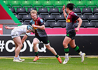 20th March 2021; Twickenham Stoop, London, England; English Premiership Rugby, Harlequins versus Gloucester; Harlequins, Gloucester; Marcus Smith of Harlequins celebrating the try while Tyrone Green of Harlequins runs through with slight grin of satisfaction