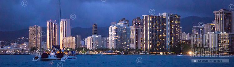 Panorama of Catamaran off Waikiki at twilight in Honolulu, Oahu