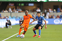 SAN JOSE, CA - JULY 24: Fabrice Picault #10 of the Houston Dynamo is defended by Luciano Abecasis #2 of the San Jose Earthquakes during a game between Houston Dynamo and San Jose Earthquakes at PayPal Park on July 24, 2021 in San Jose, California.