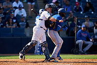 New York Yankees catcher Josh Thole (30) throws down to second base as Anthony Alford (30) bats during a Spring Training game against the Toronto Blue Jays on February 22, 2020 at the George M. Steinbrenner Field in Tampa, Florida.  (Mike Janes/Four Seam Images)