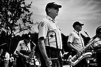 A marching band waits for the start of the 4th of July parade in Amherst, New Hampshire. Republican presidential candidates Mitt Romney and Jon Huntsman walked in the parade as part of their campaign for the 2012 presidential election.