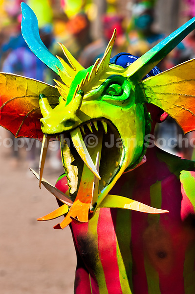 """A Cora Indian man, wearing a scary colorful demon mask, takes a part in the religious ritual ceremony of Semana Santa (Holy Week) in Jesús María, Nayarit, Mexico, 22 April 2011. The annual week-long Easter festivity (called """"La Judea""""), performed in the rugged mountain country of Sierra del Nayar, merges indigenous tradition (agricultural cycle and the regeneration of life worshipping) and animistic beliefs with the Christian dogma. Each year in the spring, the Cora villages are taken over by hundreds of wildly running men. Painted all over their semi-naked bodies, fighting ritual battles with wooden swords and dancing crazily, they perform demons (the evil) that metaphorically chase Jesus Christ, kill him, but finally fail due to his resurrection. La Judea, the Holy Week sacred spectacle, represents the most truthful expression of the Coras' culture, religiosity and identity."""