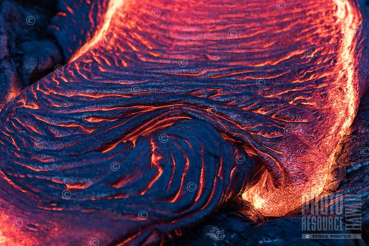 Blue Lava Texture: Dusk or dawn creates a blue light effect on black lava, Pulama Pali (part of Holei Pali), Hawai'i Volcanoes National Park, Hawai'i Island, January 2018.