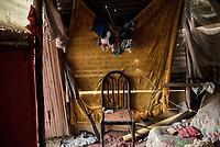 BOGOTA - COLOMBIA, 27-05-2020: Sala de una familia que un se encuentra en el barrio Altos de La Estancia. Mas de 200 familias terminan el proceso de desalojo en el predio La Estancia al sur de Bogotá quedando sin ninguna ayuda ni un techo donde vivir durante la cuarentena total en el territorio colombiano causada por la pandemia  del Coronavirus, COVID-19. / A family room that is located in the Altos de La Estancia neighborhood. More than 200 families are evicted from La Estancia farm at south of Bogota city and they left withoput any help and shelter to live during total quarantine in Colombian territory caused by the Coronavirus pandemic, COVID-19. Photo: VizzorImage / Mariano Vimos / Cont