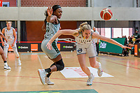 Nicole Elabosi (33) of Nigeria and Becky Massey (25) of Belgium pictured during a basketball game between the national teams of Belgium , called the Belgian Cats , and Nigeria on Sunday 30 th of May 2021 in Kortrijk , Belgium . PHOTO SPORTPIX.BE | SPP | STIJN AUDOOREN