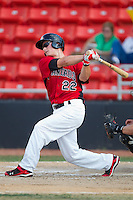 Matt West #22 of the Hickory Crawdads follows through on his swing against the Greensboro Grasshoppers at  L.P. Frans Stadium July 10, 2010, in Hickory, North Carolina.  Photo by Brian Westerholt / Four Seam Images