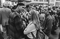 """Pretty girl attracts attention of  guys at NYC St. Patrick's Day parade.<br /> Copyright ©2017. Exhibited by """"Lost Rolls America"""" at 2017 Photoville."""
