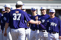 Connor Lourey (37) of the High Point Panthers bumps fists with teammate Hunter Lee (2) during player introductions prior to the game against the UNCG Spartans at Willard Stadium on February 14, 2015 in High Point, North Carolina.  The Panthers defeated the Spartans 12-2.  (Brian Westerholt/Four Seam Images)