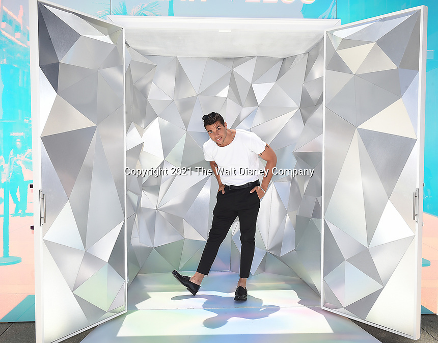 """SANTA MONICA, CA - JUNE 11: Mason Gooding poses for a photo at a special photo-activation in honor of Pride Month and the Season 2 premiere of the Hulu Original Series """"Love, Victor,"""" on June 11, 2021 in Santa Monica, California. (Photo by Frank Micelotta/Hulu/PictureGroup)"""