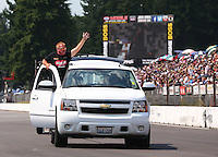 Aug. 2, 2014; Kent, WA, USA; NHRA top fuel dragster driver Terry McMillen waves to the crown during qualifying for the Northwest Nationals at Pacific Raceways. Mandatory Credit: Mark J. Rebilas-