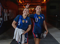 HOUSTON, TX - JUNE 13: Kelley O'Hara #5 and Alex Morgan #13 of the USWNT enter the field before a game between Jamaica and USWNT at BBVA Stadium on June 13, 2021 in Houston, Texas.