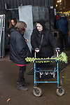 Rural poverty people at a Christmas market and turkey auction. Norfolk. Uk 2018. Woman just bought a Brussel sprout stick for £1-00. Fabian Eagle Auctions.