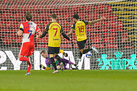 Andre Gray of Watford (right) scores the opening goal  during the Sky Bet Championship behind closed doors match between Watford and Wycombe Wanderers at Vicarage Road, Watford, England on 3 March 2021. Photo by David Horn.