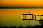 A fisherman enjoys the sunset on a dock near St. Teresa southwest of Tallahassee, Florida.  (Photo by Mark Wallheiser/TallahasseeStock.com)  (Mark Wallheiser/TallahasseeStock.com)