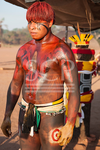 Xingu Indigenous Park, Mato Grosso, Brazil. Aldeia Matipu. Autamaco Matipu the champion, prepares to fight Huka-Huka during the Kuarup funeral ceremony.