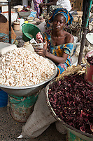 Senegal, Touba.  Street Vendor Selling Baobab Fruit, rich in Calcium and Vitamin C.  On the right are hibiscus petals, used to make a drink called bisap.
