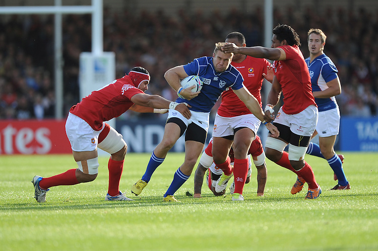 Johan Deysel of Namibia is tackled by Sione Kalamafoni and Jack Ram of Tonga during Match 20 of the Rugby World Cup 2015 between Tonga and Namibia - 29/09/2015 - Sandy Park, Exeter<br /> Mandatory Credit: Rob Munro/Stewart Communications