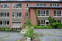 The Green Building on the campus of the Fernald Developmental Center in Waltham, Massachusetts, USA, previously served as housing and a recreation center for residents with severe mental disabilities.  The building is now largely unused.