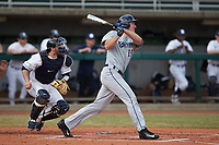 Joe Gellenbeck (19) of the Xavier Musketeers follows through on his swing against the Penn State Nittany Lions at Coleman Field at the USA Baseball National Training Center on February 25, 2017 in Cary, North Carolina. The Musketeers defeated the Nittany Lions 10-4 in game one of a double header. (Brian Westerholt/Four Seam Images)