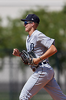 GCL Tigers West center fielder Parker Meadows (14) jogs back to the dugout during a game against the GCL Tigers East on August 8, 2018 at Tigertown in Lakeland, Florida.  GCL Tigers East defeated GCL Tigers West 3-1.  (Mike Janes/Four Seam Images)