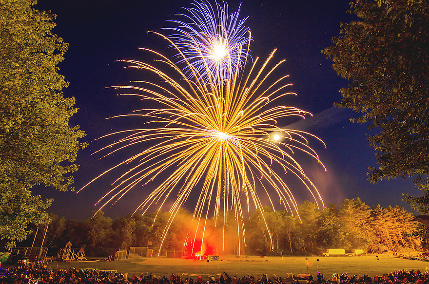 A pair of shells explode above the crowd during the Fourth of July celebration in Ashland, New Hampshire.