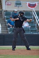 Home plate umpire Thomas O'Neil calls a batter out on strikes during the South Atlantic League game between the Hagerstown Suns and the Kannapolis Intimidators at Kannapolis Intimidators Stadium on August 27, 2019 in Kannapolis, North Carolina. The Intimidators defeated the Suns 5-4. (Brian Westerholt/Four Seam Images)