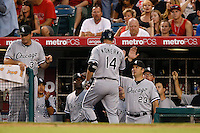 Paul Konerko #14 of the Chicago White Sox is greeted by manager Robin Ventura #23 after scoring against the Los Angeles Angels at Angel Stadium on September 22, 2012 in Anaheim, California. Los Angeles defeated Chicago 4-2. (Larry Goren/Four Seam Images)