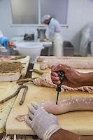 France, Indre-et-Loire (37), Vallée de la Loire classée Patrimoine Mondial de l' UNESCO, France, Indre-et-Loire (37), Vouvray: Maison Hardouin à Vouvray, charcutier de tradition- Fabrication de l'andouillette  de Vouvray à la corde // France, Indre et Loire, Loire Valley listed as World Heritage by UNESCO, France, Indre et Loire, Vouvray: Maison Hardouin à Vouvray , traditional charcutier,  making the Vouvray String andouillettes