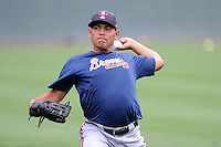 Pitcher Andy Otero (19) of the Rome Braves warms up before a game against the Greenville Drive on Thursday, July 31, 2014, at Fluor Field at the West End in Greenville, South Carolina. Rome won the rain-shortened game, 4-1. (Tom Priddy/Four Seam Images)