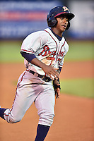 Danville Braves shortstop Ozhaino Albies #17 runs to third during a game against the Johnson City Cardinals at Howard Johnson Field September 4, 2014 in Johnson City, Tennessee. The Braves defeated the Cardinals 6-1. (Tony Farlow/Four Seam Images)