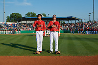 Batavia Muckdogs Gerardo Nunez (2) and Jack Strunc (47) during the national anthem before a NY-Penn League game against the State College Spikes on July 3, 2019 at Dwyer Stadium in Batavia, New York.  State College defeated Batavia 6-4.  (Mike Janes/Four Seam Images)