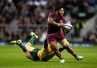 Photo: Richard Lane/Richard Lane Photography. England v Australia. QBE Autumn Internationals. 17/11/2012. England's Manu Tuilagi offloads in the tackle.