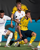 CHARLOTTE, NC - JULY 20: Robbie Burton #41, Riccardo Saponara #10 and Gaetano Castrovilli #20 all battle for the ball during a game between ACF Fiorentina and Arsenal at Bank of America Stadium on July 20, 2019 in Charlotte, North Carolina.