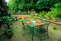 Brunch in the garden- Easy care backyard with large brick patio opening to wooded back lot, midwest USA