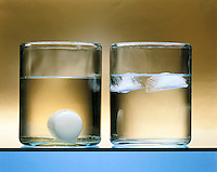 DENSITY: SOLID & LIQUID STATES OF PARAFFIN & WATER<br /> Comparison Of The Liquid And Solid Phases<br /> (left) The solid phase of paraffin is denser than the liquid phase and sinks to the bottom of the container of liquid paraffin. (right) Ice or the solid phase of water is less dense than its liquid phase and floats to the top.