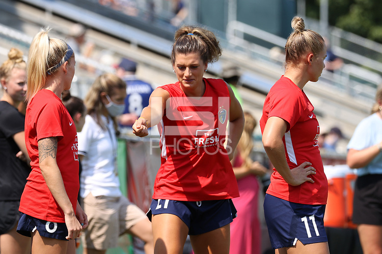 CARY, NC - SEPTEMBER 12: Cari Roccaro #21 of the North Carolina Courage breaks into a river dance while warming up before a game between Portland Thorns FC and North Carolina Courage at Sahlen's Stadium at WakeMed Soccer Park on September 12, 2021 in Cary, North Carolina.