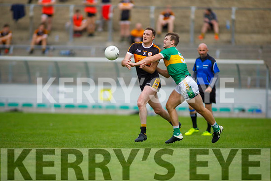 A tussle for possession between Brendan O'Sullivan and Shane O'Connor of John Mitchels in the Tralee Town Board Senior Football Championship final.