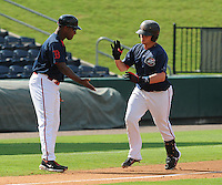 Catcher Christian Vazquez (15) of the Greenville Drive is congratulated by manager Billy McMillon (51) after hitting a home run in the first game of a doubleheader against the Rome Braves on August 15, 2011, at Fluor Field at the West End in Greenville, South Carolina. (Tom Priddy/Four Seam Images)