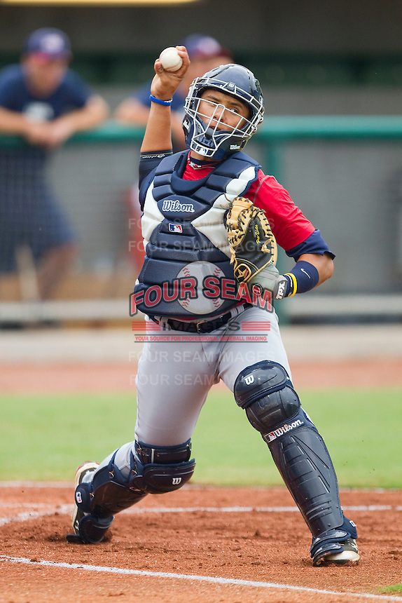 Catcher Elvin Soto #20 makes a throw to first base during infield practice during the USA Baseball 18U National Team Trials at the USA Baseball National Training Center on June 30, 2010, in Cary, North Carolina.  Photo by Brian Westerholt / Four Seam Images